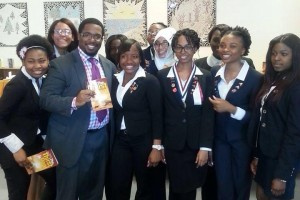 Geo taking a picture with student leaders after a book signing