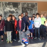 Geo takes pictures with visiting class to the Yogi Berra Museum