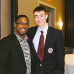 Geo Derice posing with student from leadership conference
